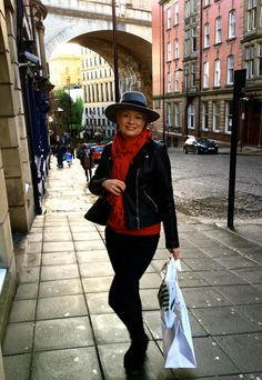 Midlifechic Christmas city shopping outfit layers of red and black topped with a fedora for bright Christmas spirit  #over40style #over40fashion