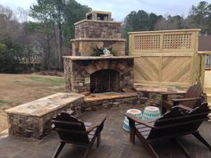 Archadeck designed and built this stacked stone fireplace on a Belgard paver patio nestled within a KDAT deck surrounding a hot tub with a privacy wall for the ultimate cozy feel..