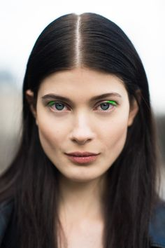 Lime green eyeliner spotted on a model during #PFW! #streetstyle @Le 21ème
