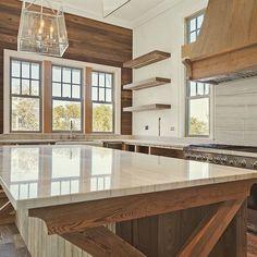 Wood Kitchen Cabinet. Oak French kitchen with sleek quartzite and lantern pendants. #Oak #KItchen #FrenchOak #Cabinet #Quartzite Old Seagrove Homes.