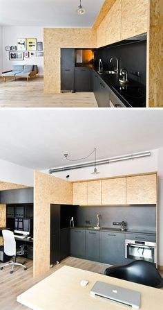 This matte black kitchen is part of a small apartment designed as a live/work…