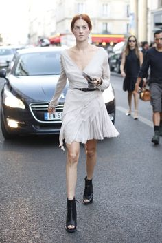 Taylor Tomasi-Hill nailed it in a flowy greige dress and black booties.