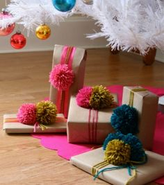 Cute yarn pom poms for presents.  I'm trying to figure out what to do with my leftover yarn and I think this is a great idea.