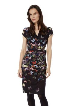 afc662c01e7 In a comfy wrap style butterfly print dress features a waist tie