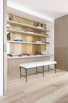 gold bookshelf against natural limed ash cupboards