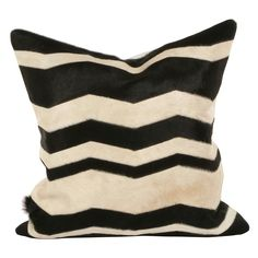 A classic and beloved pattern gets an unexpected twist with the Modern pillow. Combining the Western look of genuine cowhide with the modern chevron obsession, this pillow adds a bold flavor to a sofa, chair or bed. 22in Square; Genuine hide; Feather/down insert included; Made in the USA; Dry clean only