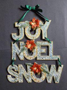 'Joy, Noel, Snow' Christmas hanging decoration. - Imagination Craft's -  MDF Christmas words.  White chalk MDF paint.  White stencil Medium.  Metal soatula.  Alchemy Waxes - Cobalt & Peridot.  Starlight paints - Menthol, Antique Gold, & Orange oxidised.  Pine branch & Poinsettia dies - Marianne Design.   Star ring die - Memory Box.   August 2016.   Designed by Jennifer Johnston.
