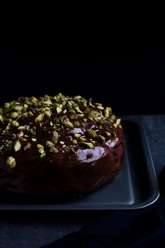 Look at that chocolate shine!!! This chocolate cake is extremely indulgent (it feels a bit like the cake from Roald Dahl's Matilda...) Surprisingly, it has courgettes inside the mix and  is finished with a sprinkling of crunchy pistachios on the top. #food #chocolate #chocolatecake #cake #dessert #baking #foodporn #delicious #freestock #stockphoto #free