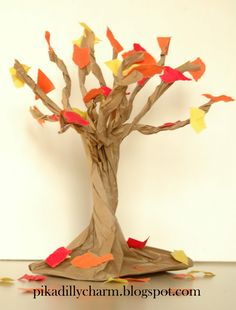 This craft works well for Kindergarten/ early elementary, or younger kids who are really into crafts. A bit more time consuming, but simple enough w/ adult assistance.  Need: paper bag (or grocery size paper bag for giant tree) and fall colored construction paper.