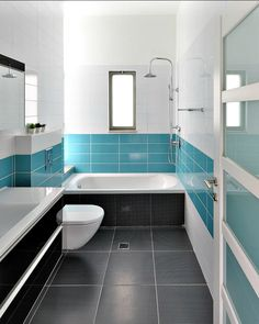 Love the combo and breakup of colours. Dark floors, colour band, topped with a band of white tiles and then white paint. Lovely fresh feel with a colour injection