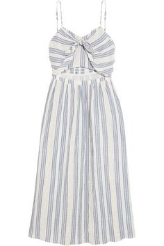 """""""The love of travel and the beach"""" is at the heart of LoveShackFancy's collections. This 'Jenna' dress is cut from an airy crinkled cotton-blend woven with sky-blue and gold stripes. It has a cutout at the most flattering part of your waist and is finished with a pretty bow."""