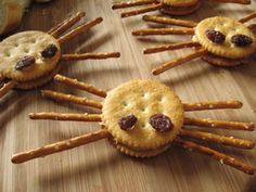 Spider Crackers are a fun and easy appetizer for your party.  This is one the kids can help with making and they are a healthy snack.  You can also use red frosting to make the eyes and use cheese spread (in case of peanut allergies).  The kids love them.