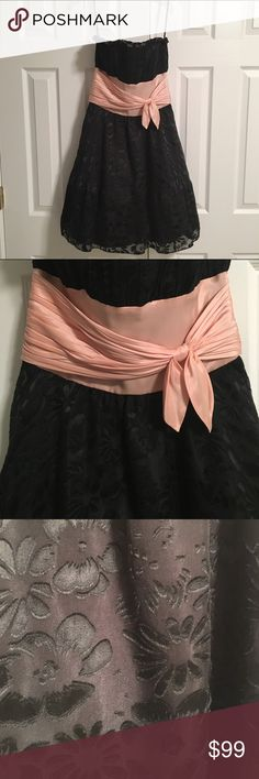 🆕 Strapless Betsey Johnson Dress Sweet & sophisticated strapless dress for any special occasion. Worn twice purchased at the Betsey Johnson store. Layer of black tulle for added puffiness. Bow is light pink/peach. Zipper in back. Never been altered. Made or rayon & silk. Lining polyester. Smoke & pet free home. Betsey Johnson Dresses Strapless