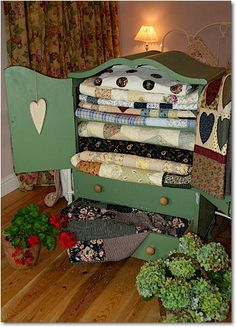 This looks like an old TV cabinet re-furbished into a beautiful Quilt Cabinet...Love it all!  <3