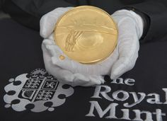 The First World War gold kilo coin and the 40th oz gold Britannia coin about to be examined at the 2015 Trial of the Pyx: http://www.royalmint.com