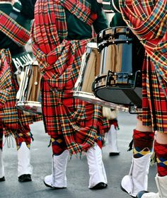 Drummers marching very handsomely in head to toe tartan.