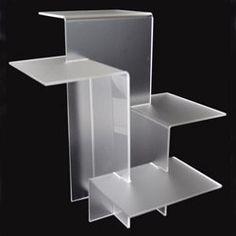 Four Tier Acrylic Riser Display and Fixture Store http://www.amazon.com/dp/B007PKGNNQ/ref=cm_sw_r_pi_dp_OdGQub1DXVDBM