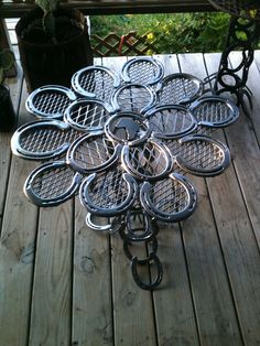 The Cowboy's Patio Table : constructed from used horse shoes. The table is powder coated to prevent rust and makes this a durable table inside or out.
