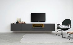pastoe has contributed for over 100 years to the typical dutch modern design culture in furniture. the line of cabinets is world famous Floating Entertainment Unit, Floating Tv Unit, Floating Tv Stand, Nordic Living Room, Living Room Tv, Living Spaces, Wall Mount Tv Shelf, Commode Design, Tv Unit Design