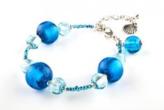 Bransoletka błękitna - szkło weneckie i koraliki rokail - blue lampwork glass / seed beads and seashell bracelet http://corallia.pl/bransoletki/bransoletka-blekitna-szklo-weneckie-i-koraliki-rokail.html#.VNn4ui7Hg2g
