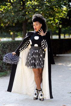 Janelle Monae Rocks Paris Fashion Week in a Stella McCartney Black Pom Pom Sweatshirt, an Akris Cream Suit,