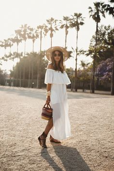 INFINITE PALM TREES - Lovely Pepa by Alexandra. White off the shoulder ruffle open maxi dress+brown lace-up flat sandals+colorfull raffia basket-bag+straw sun hat+sunglasses+ivory scarf+necklace. Summer Casual Outfit 2017