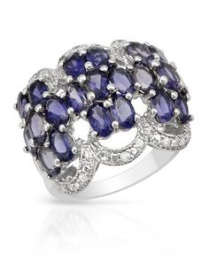 Ring With Genuine Zircons - Size 5.5 Wonderful ring with genuine iolites and zircons well made in 925 sterling silver. Total item weight 6.0g. Gemstone info: 21 iolites, 4.05ctw., oval shape and bluish violet color, 41 zircons, 0.21ctw., round shape and white color.