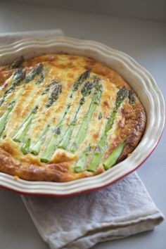 Crustless quiche with bacon, gruyere, asparagus, leeks & roasted tomatoes.