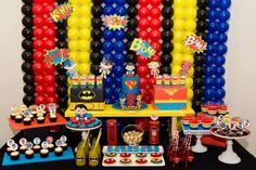 Superhero boy birthday party dessert table with a balloon backdrop!  See more party planning ideas at CatchMyParty.com!