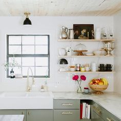 Open shelves in bright white kitchen with satellite fixture by schoolhouse electric