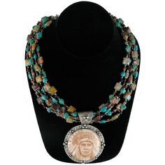We love this statement piece! The necklace will be featured in one of our Fall ads paired with a Navajo-inspired cardigan. American turquoise and garnet stone strands with large pendant featuring Chief Joseph.