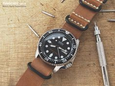 Factory SKX007 with a leather strap.