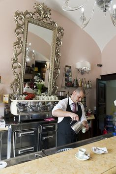 Barista using espresso coffee machine in cafe, Sassari, Sardinia,  Italy