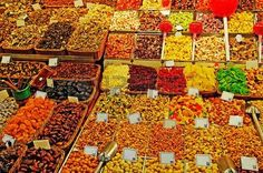 Abundance of nuts fruits sweet things at Barcelona market  Stock Photo