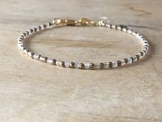 A personal favourite from my Etsy shop https://www.etsy.com/no-en/listing/601559823/gold-pyrite-grey-moonstone-bracelet-gold