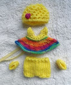 Check out this item in my Etsy shop https://www.etsy.com/uk/listing/225046616/hand-knitted-dolls-clothes-for-8-ooak