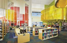 "Newcastle County Bear Library, DE, takes advantage of its 40-foot ceilings to display ""Lanterns,"" constructed of sheets of polycarbonate and bent metal conduit and suspended over the main service desks to ""light the way."""