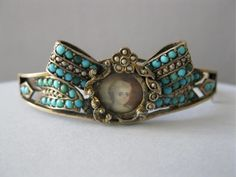 A Victorian silver and turquoise portrait bracelet.
