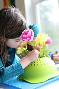 I love this idea for toddlers language development too.  Targets - more flowers,  in, Put it in.