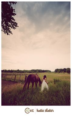 bride with horse - love this shot from a distance