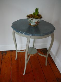This occasional table is painted in various shades of Annie Sloan paint to give a French look and has a faux marble top. £65