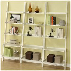 This white, tiered ladder shelf has a unique look that will add style to any storage area or room in your home. Solid wood and MDF materials form a sturdy base for five tiers to place decorations, books, or any valuables you would like to display.