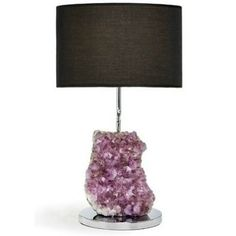 The dramatic Cielo Amethyst Lamp from Rablabs contrasts the organic beauty of natural stone with elegant, modern design. Held in place by the lamp itself, this lighting accessory is a dramatic statement piece that can stand alone to complement any decor scheme. Made of chrome-plated metal, requiring no polishing and topped with a chic black fabric shade, this light fixture is a must-have!