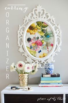 Pick up an inexpensive Ikea frame and a pretty piece of fabric to create your own earring organizer that do...