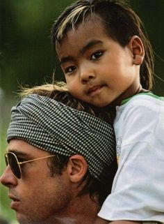 Brad Pitt with one of his adopted sons