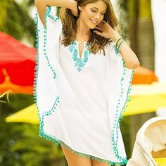 Bikini cover up Beautiful white cover up with teal embroidery.  One size fits all from S to L.          Measurements:              Lenght - 30 inch(77cm).  Width - 50 inch (126cm).  Sleeves from Neck - 15 inch(38cm). Swim Coverups