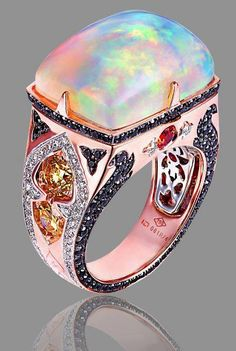 Opal in Rose gold with black and white diamonds