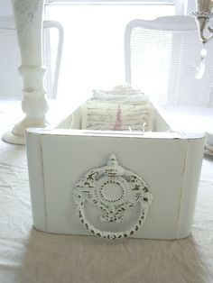 Great idea for rolled wash cloths in an old sewing machine drawer.