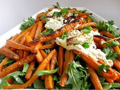 Burnt Carrots with warm goat cheese on an arugula + parsley salad.