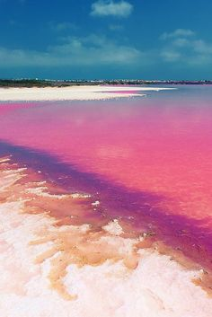 The water is pink in Laguna Salada de Torrevieja due to a special type of algae. What girl wouldn't want to lounge on a pink beach? Check out 19 more unreal travel destinations on avenlylanetravel.com